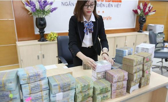 Lãi suất VND giảm sâu ép tỷ giá, Ngân hàng Nhà nước hối hả điều tiết