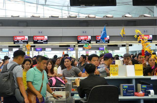 Cẩn trọng khi mua vé bay Tết - Ảnh 1.