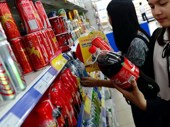 Coca-Cola Việt Nam bị phạt, truy thu thuế hơn 821 tỉ - Ảnh 1.