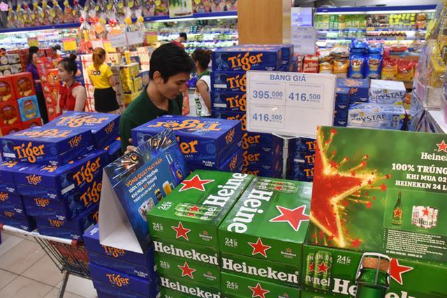 Giảm nhậu, giá bia Tết vẫn tăng - Ảnh 1.