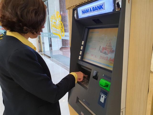 Cận Tết, cảnh báo thủ đoạn lừa tiền trong tài khoản - Ảnh 1.
