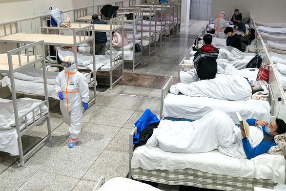 Cập nhật dịch corona ngày 7-2: Hồ Bắc thêm 69 người chết, ca nhiễm mới giảm  - Ảnh 1.