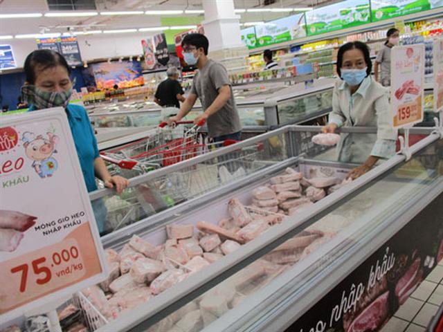 Giá thịt heo nhập khẩu sắp rẻ hơn - Ảnh 1.