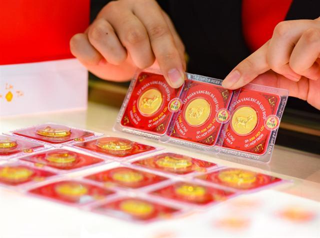 Mỗi lượng vàng SJC tăng gần 10 triệu đồng chỉ trong tháng 7 - Ảnh 1.